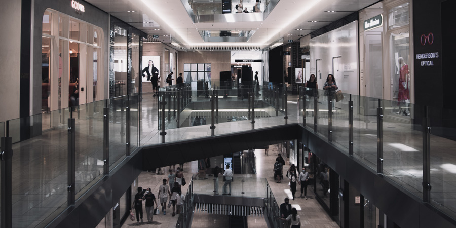people moving through retail space