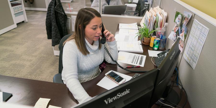 Logistics Management - receptionist at office desk